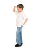 Junge, der auf Weiß aufwirft Lizenzfreies Stockbild