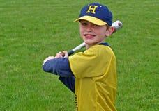 Junge, der Baseball spielt Stockbilder