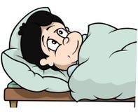 Junge, der in Bett legt Stockbilder