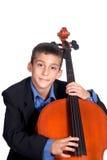 Junge, der Cello spielt Lizenzfreie Stockbilder