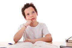 Junge, der das Bohren studiert Lizenzfreies Stockfoto