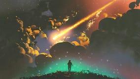 Junge, der den Meteor im bunten Himmel schaut Stockfotografie