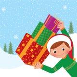 Junge, der ein Weihnachtsgeschenk anhält Stockfoto
