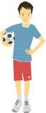 Junge, der eine Fußball-Kugel anhält Stockbilder