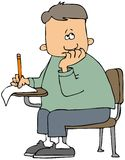 Junge, der eine Prüfung nimmt Stockfotos
