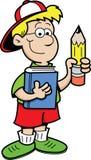 Junge, der einen Bleistift und ein Buch anhält Stockbild