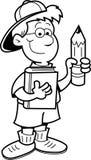 Junge, der einen Bleistift und ein Buch anhält Lizenzfreie Stockfotos