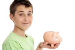 Junge, der einen Geldkasten anhält Stockbilder