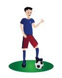 Junge, der Fußball spielt Stockfotografie