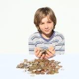 Junge, der Geld hält Stockbild