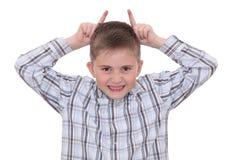 Junge, der Gesichter bildet Lizenzfreies Stockbild