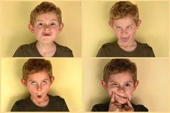 Junge, der Gesichter macht stockfotografie