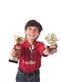 Junge, der in Konkurrenz gewinnt Stockbild
