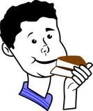 Junge, der Kuchen isst Stockfoto