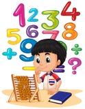 Junge, der Mathe mit Abakus tut Stockfotografie