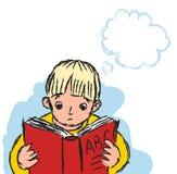 Junge, der mit Buch studiert Stockbild