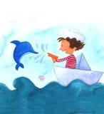 Junge, der mit einem Delphin spielt Lizenzfreies Stockbild
