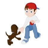 Junge, der mit Welpen spielt Stockfoto