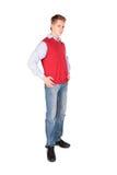 Junge in der roten Jackenaufstellung Stockfotos