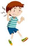 Junge, der sein Ohr verletzt Stockfotos