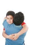Junge, der seinen Vater umarmt Stockbild