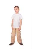 Junge in der weißen Hemdaufstellung Lizenzfreie Stockbilder