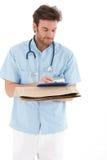 Junge Doktorschreibensanmerkungen Lizenzfreie Stockfotos