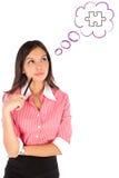 Junge durchdachte Geschäftsfrau Stockfoto