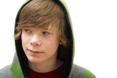 Junge in einem Hoodie stockbilder