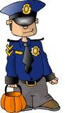 Junge in einem Polizist-Kostüm Lizenzfreie Stockfotos