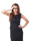 Junge entsetzte Geschäftsfrau über weißem Hintergrund Stockfotos