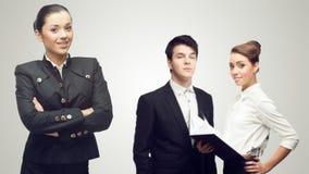 Junge erfolgreiche Geschäftsleute Stockfotos