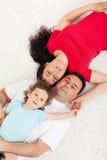 Junge Familie mit einem Kind Stockbild