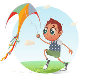 Junge fliegt seinen Drachen Stockfotos