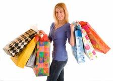 Junge Frau auf einem Einkaufen-Gelage Stockbild