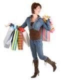 Junge Frau auf einem Einkaufen-Gelage Stockbilder