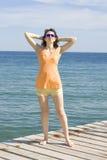 Junge Frau auf Meer Stockbild