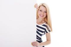 Junge Frau auf Weiß Lizenzfreie Stockfotos