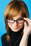 Junge Frau in den Gläsern Stockbild