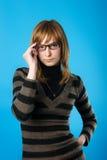 Junge Frau in den Gläsern Lizenzfreies Stockfoto