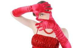 Junge Frau in den roten Handschuhen Lizenzfreie Stockfotografie