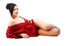Junge Frau der Sinnlichkeit im roten Kleid Lizenzfreie Stockfotos