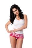 Junge Frau in der weißen Unterwäsche Stockfoto