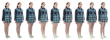 Junge Frau des Fotos während der Schwangerschaft im karierten Hemd Stockbilder