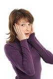 junge Frau, die überrascht schaut Stockbild