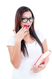 Junge Frau, die überrascht schaut Stockbilder