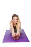 Junge Frau, die Übungen tut Lizenzfreie Stockfotos