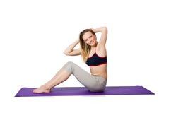 Junge Frau, die Übungen tut Stockfoto