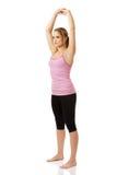 Junge Frau, die Aerobic-Übung tut Stockbilder