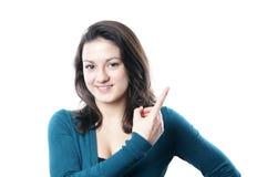 Zeigen der jungen Frau Stockfoto